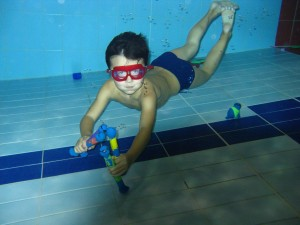 boy snorkelling in the small swimming pool